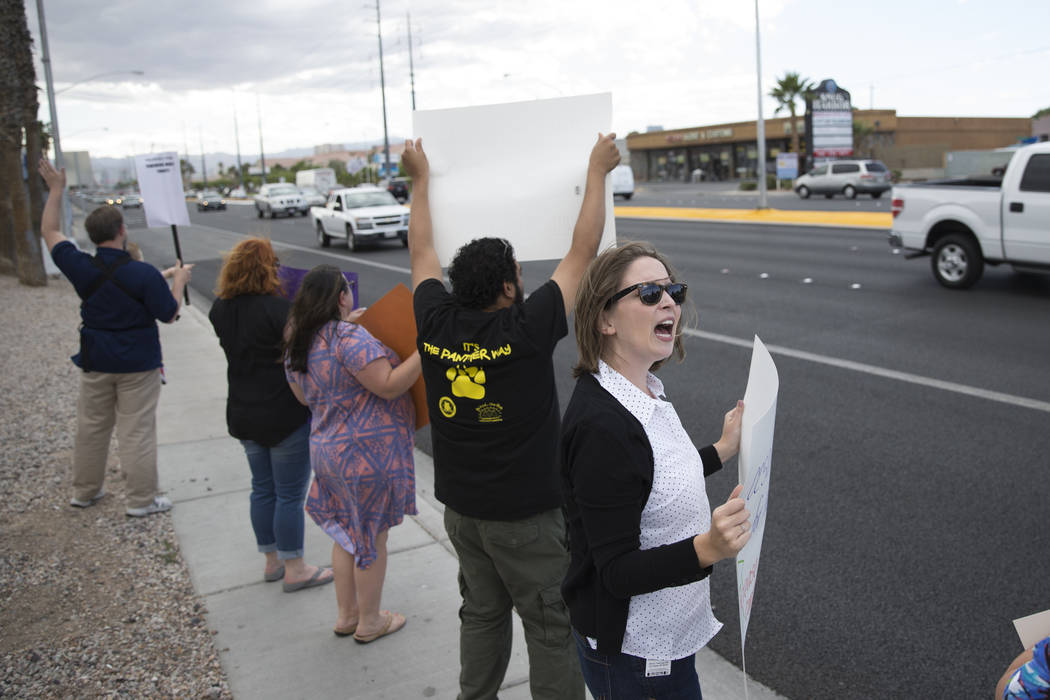 School psychologist Jordan Wenger attends a rally for affordable health insurance with teachers and supporters outside of the Clark County School District Education Center before a board meeting o ...