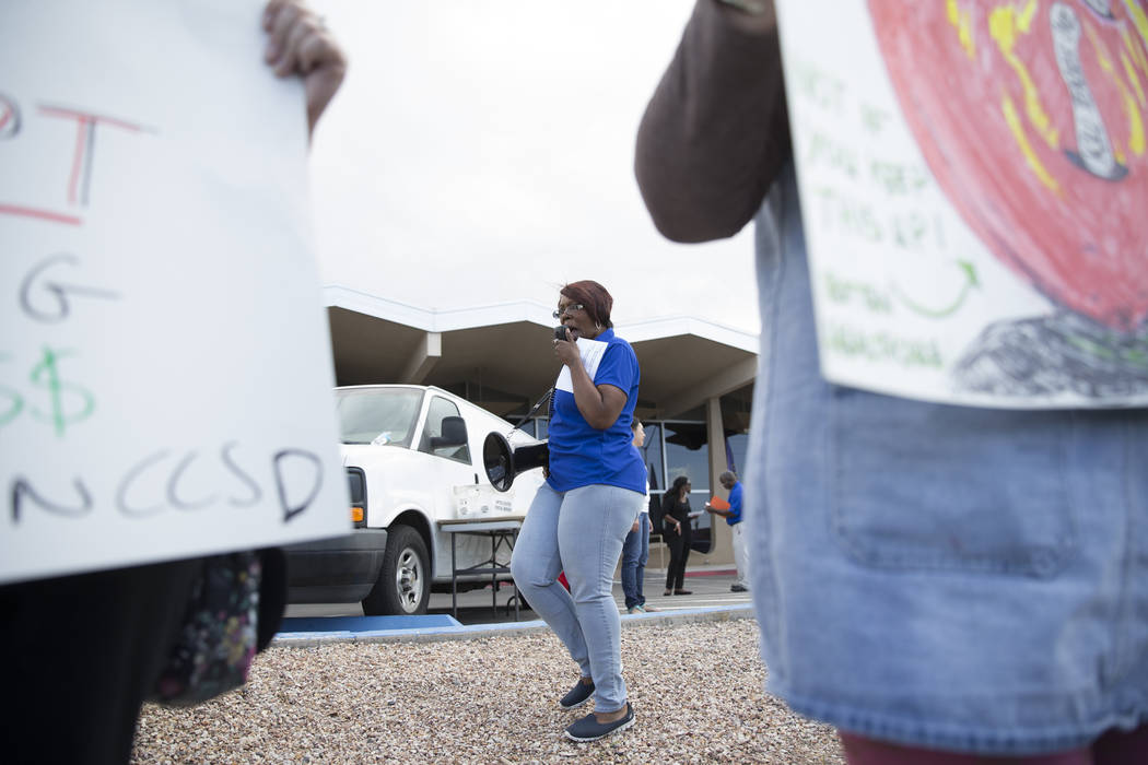 Linda Jones, UniServ director for the Clark County Education Association, attends a rally for affordable health insurance with teachers and supporters outside of the Clark County School District E ...