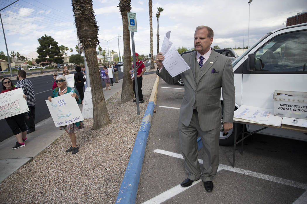 Clark County School District Board trustee Kevin Child attends a rally for affordable health insurance with teachers and supporters outside of the Clark County School District Education Center bef ...