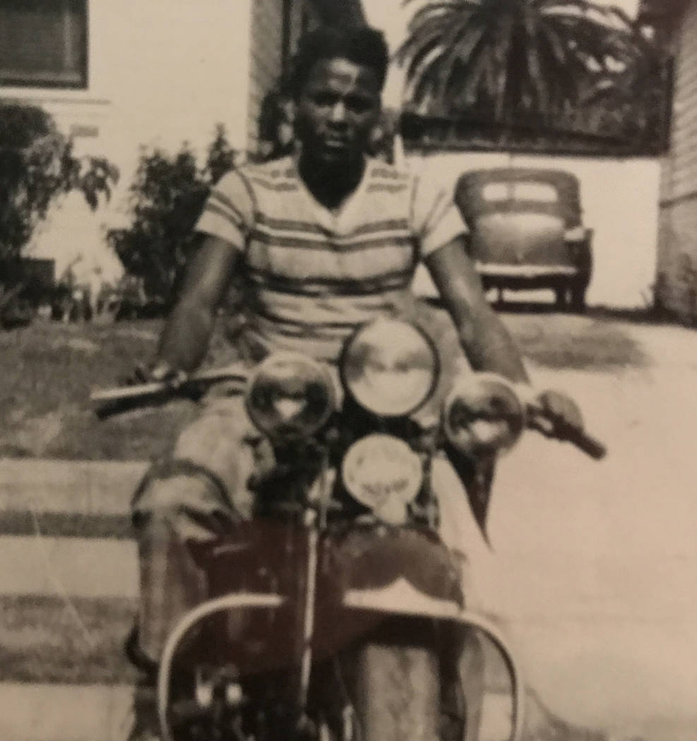 "After his honorable discharge from the Army, Vernice ""Lucky"" Gaar sits on his Harley ""Hog"" in April 1946 at the family's home in Santa Barbara, Calif. Photo pro ..."