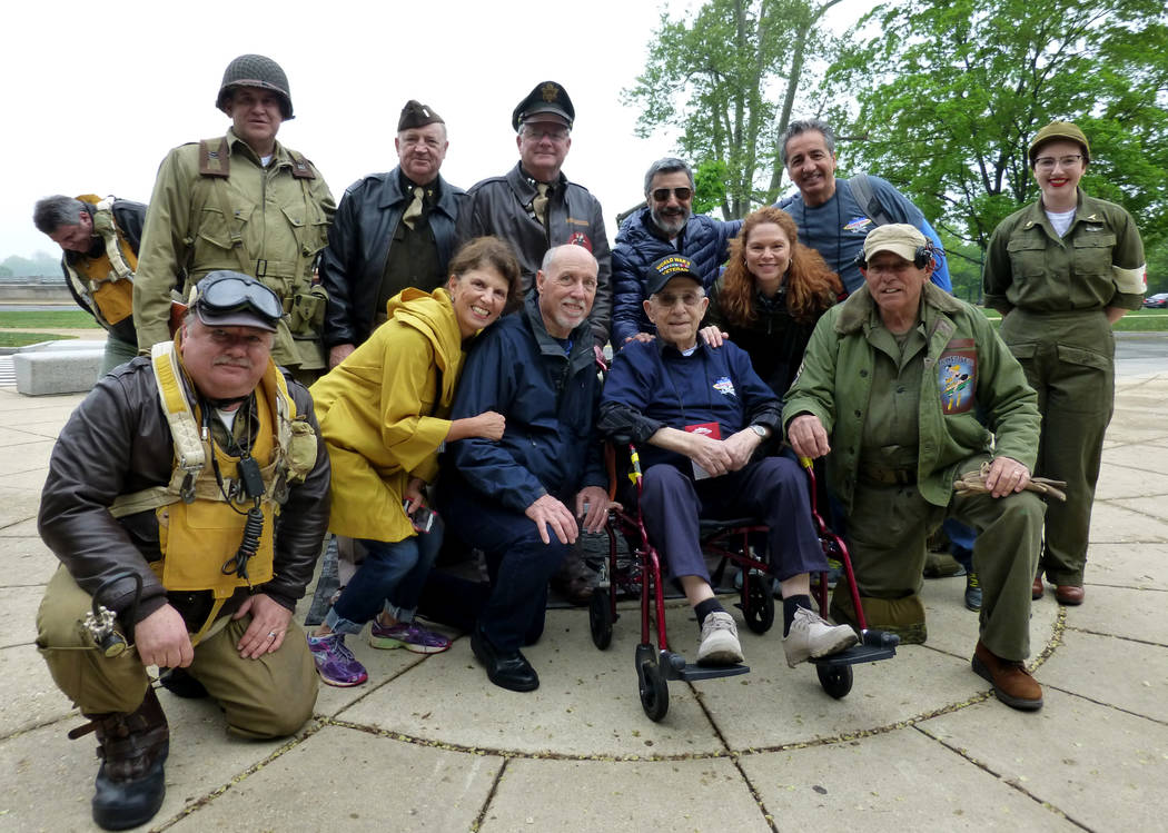 Military role players surround Frank Costa in wheelchair at the National World War II Memorial in Washington, D.C., April 22. 2017 Tony Bonnici