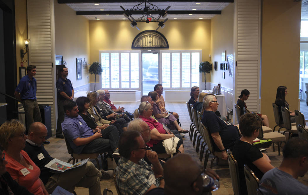 People listen as Las Vegas City Council Ward 6 candidate Kelli Ross, not pictured, speaks at a forum hosted by the Providence Homeowners Association in Las Vegas on Wednesday, May 17, 2017. Ward 6 ...