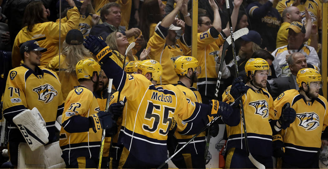 The Nashville Predators bench celebrates their go-ahead goal during the third period in Game 3 of the Western Conference final against the Anaheim Ducks in the NHL hockey Stanley Cup playoffs Tues ...