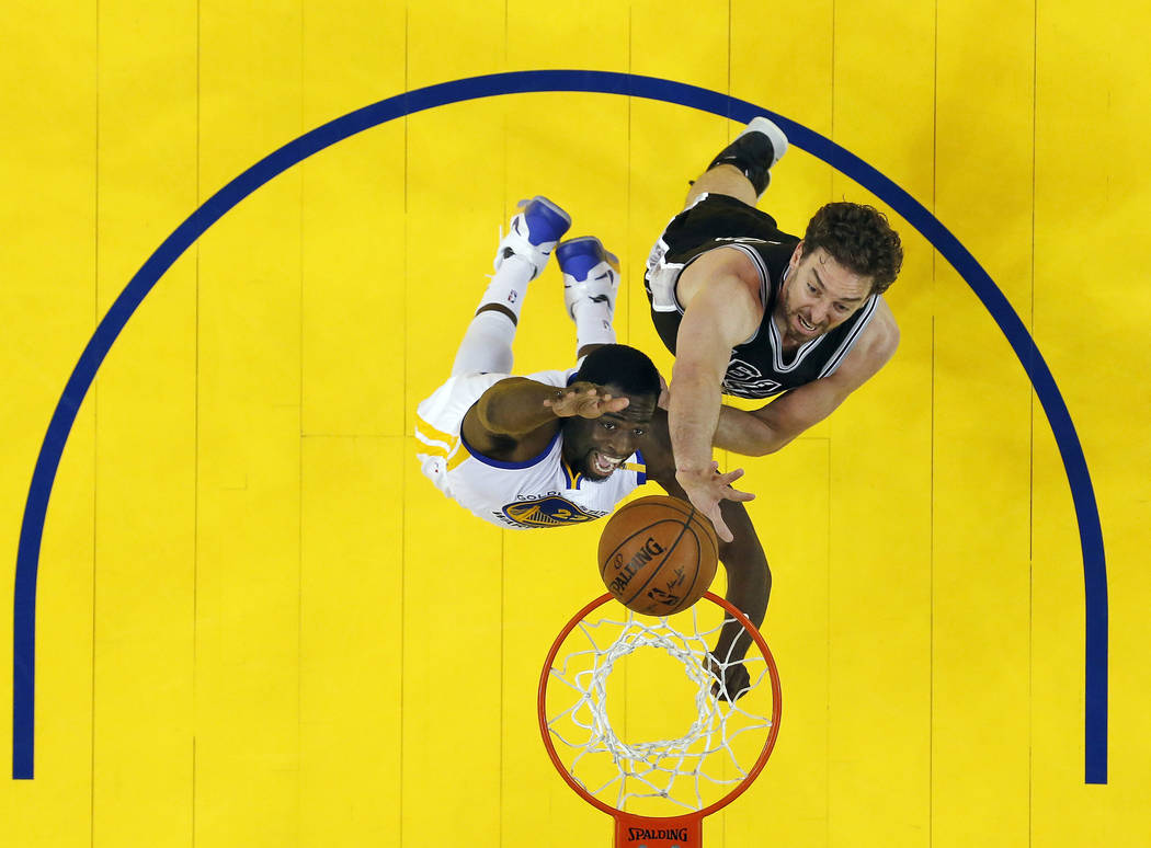 Golden State Warriors' Draymond Green, bottom, works for a rebound against San Antonio Spurs' Pau Gasol during the first half of Game 2 of the NBA basketball Western Conference finals, Tuesday, Ma ...