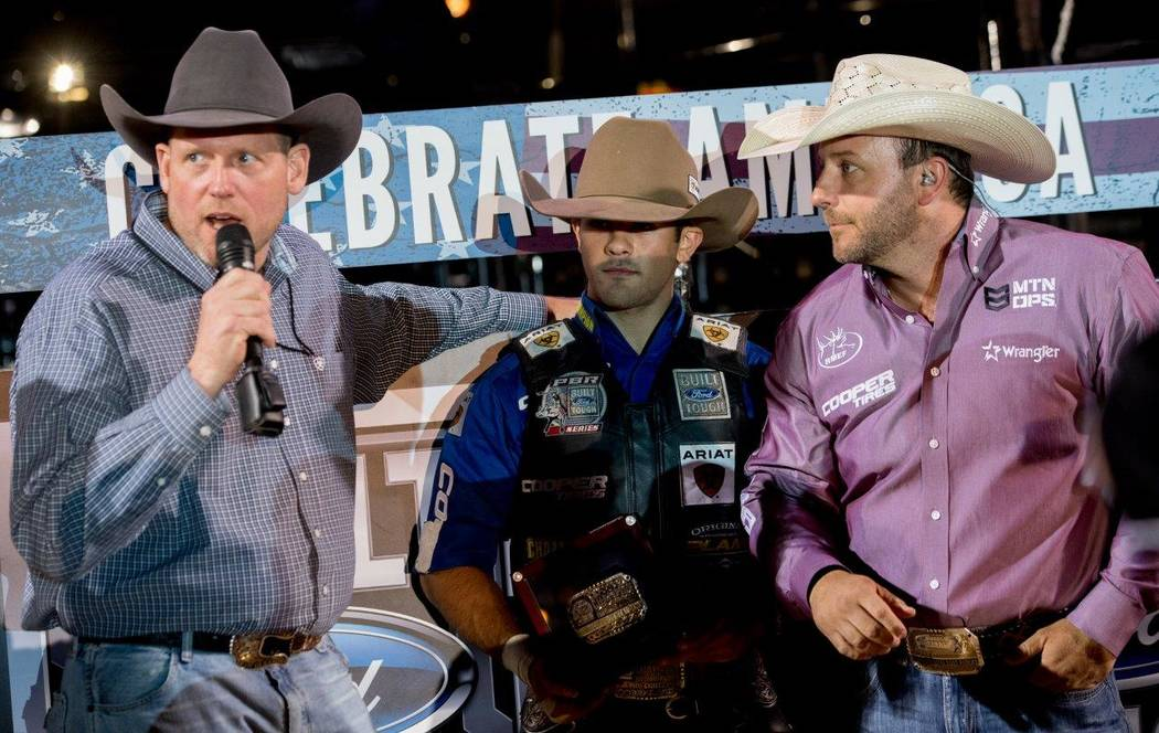 "PBR's ""Last Cowboy Standing"" on Saturday, May 13, 2017, at Las Vegas Village. Champion Kaique Pacheco, 22, of Brazil, center, is pictured here.(Tom Donoghue)"