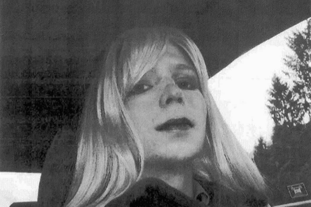 In this undated file photo provided by the U.S. Army, Pfc. Chelsea Manning poses for a photo wearing a wig and lipstick. Manning, the transgender soldier convicted in 2013 of illegally disclosing  ...
