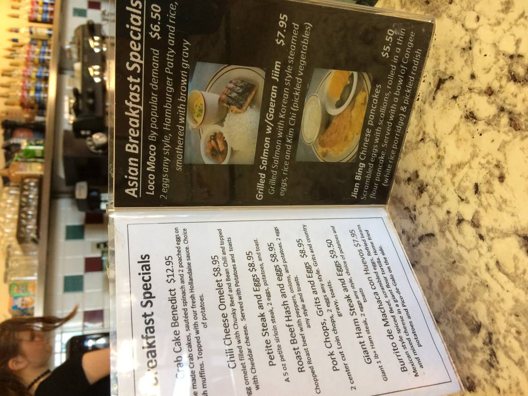 A menu minder at Norm's Diner sits on the counter March 28, 2017. The location, 3945 S. Durango Drive, is a better fit the restaurateur than where its predecessor, Eggs And, was located, he said ...