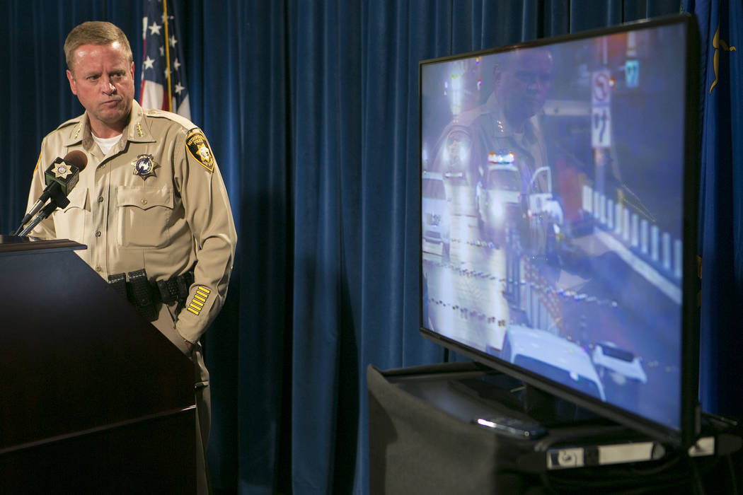 LVMPD undersheriff Keith McMahill plays security footage of the event involving Tashii Brown during a press conference at Las Vegas Metropolitan Police Department Wednesday, May 17, 2017, in Las V ...