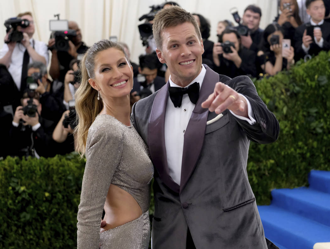 Gisele Bundchen, left, and Tom Brady attend The Metropolitan Museum of Art's Costume Institute benefit gala celebrating the opening of the Rei Kawakubo/Comme des Garçons: Art of the In-Between ex ...