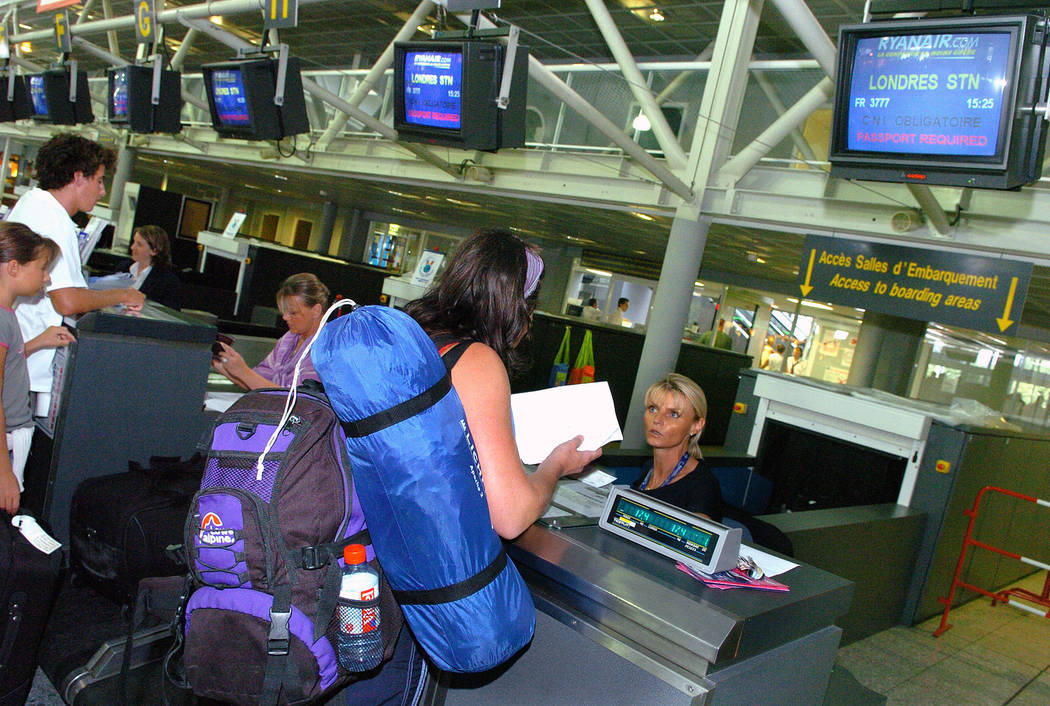 Passengers en route to London check in at Biarritz airport, southwestern France on Aug. 11, 2006. U.S. and European officials will discuss Wednesday, May 17, 2017, plans to broaden a U.S. ban on i ...
