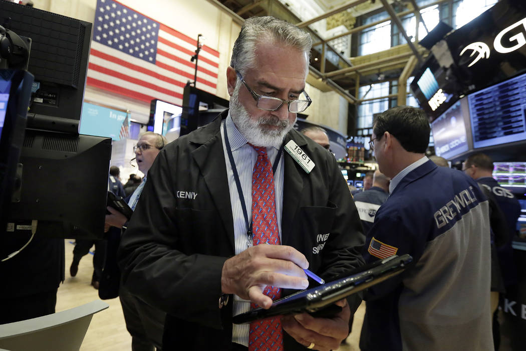 Trader Kenneth Polcari works on the floor of the New York Stock Exchange, Wednesday, May 17, 2017. Stocks are opening lower on Wall Street as banks and industrial companies fall. (Richard Drew/AP)