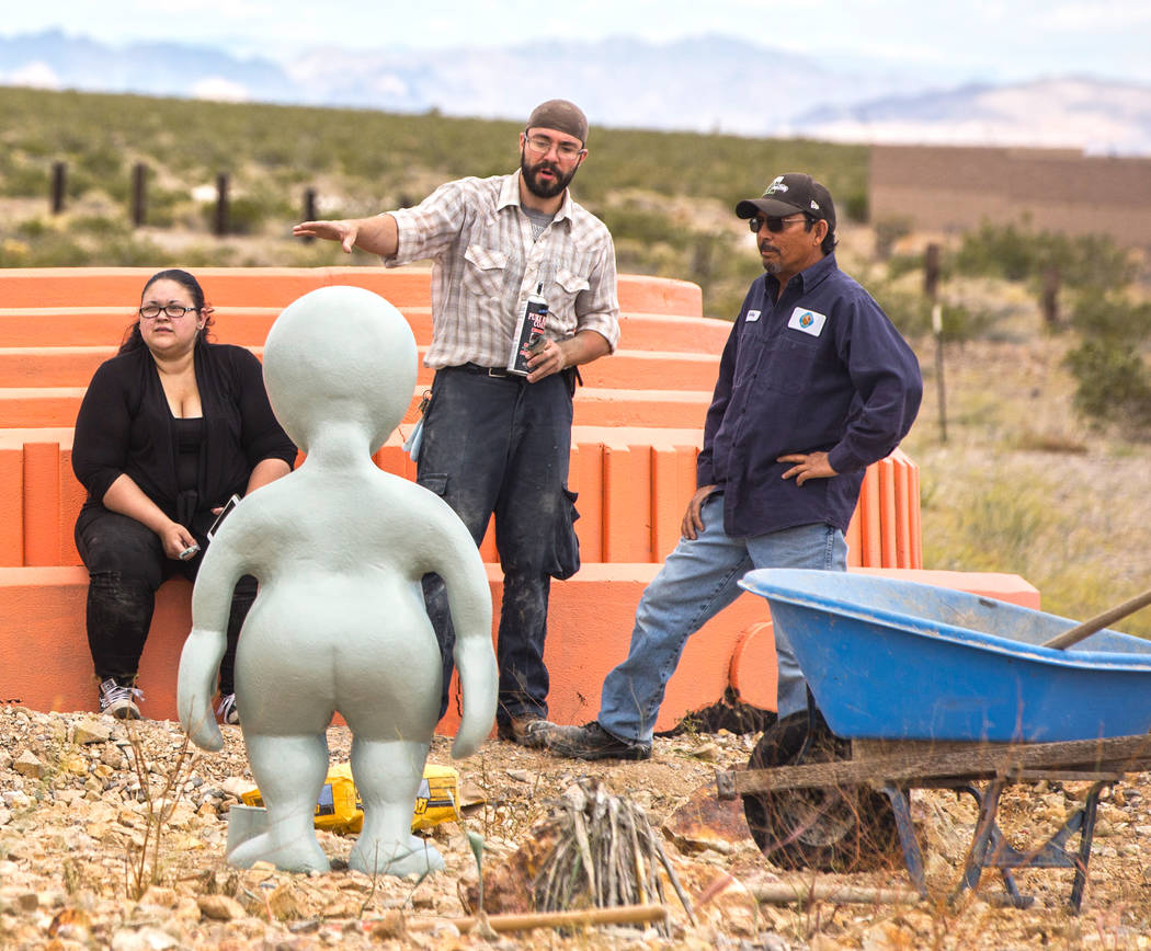 "Artist Jesse Smigel, middle, works on the installation of his sculpture ""I Told You Not to Paint It Hot Orange"" on Thursday, May 18, 2017, in Las Vegas. Benjamin Hager Las Vegas Review-Journal @be ..."