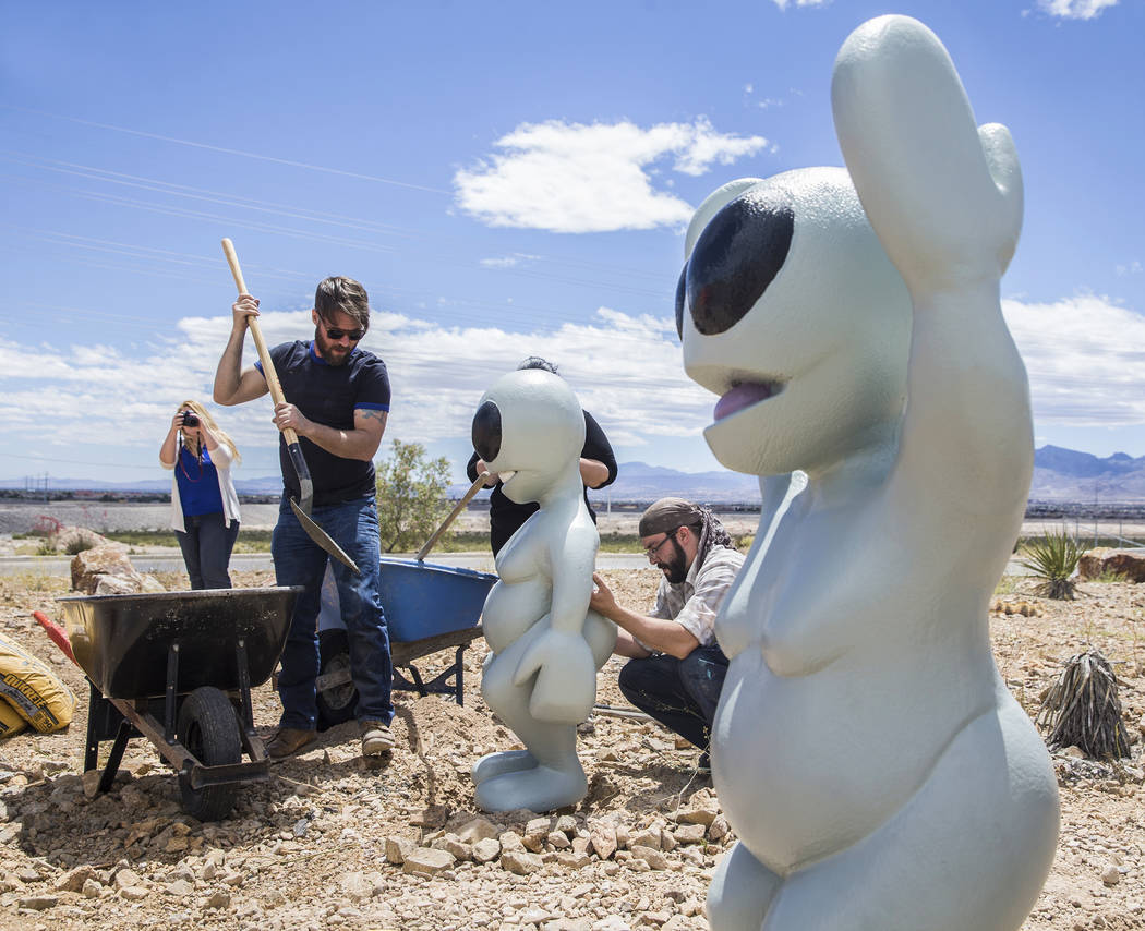 "James Norman, left, and artist Jesse Smigel work on the installation of Smigel's sculpture ""I Told You Not to Paint It Hot Orange"" on Thursday, May 18, 2017, in Las Vegas. Benjam ..."