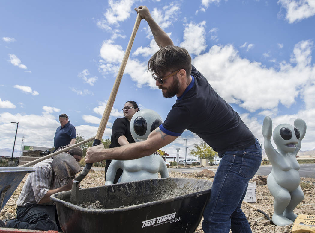 "James Norman, right, shovels concrete during the installation of artist Jesse Smigel's sculpture ""I Told You Not to Paint It Hot Orange"" on Thursday, May 18, 2017, in Las Vegas.  ..."