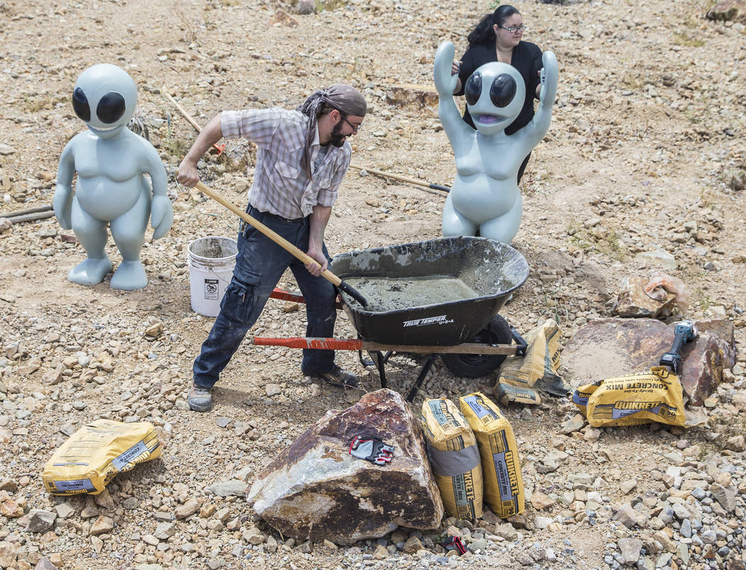 "Artist Jesse Smigel, left, and Gia Ray work on the installation of Smigel's sculpture ""I Told You Not to Paint It Hot Orange"" on Thursday, May 18, 2017, in Las Vegas. Benjamin Hager Las Vegas Revi ..."