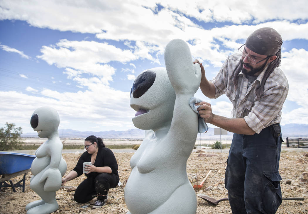 "Artist Jesse Smigel, right, and Gia Ray work on the installation of Smigel's sculpture ""I Told You Not to Paint It Hot Orange"" on Thursday, May 18, 2017, in Las Vegas. Benjamin H ..."