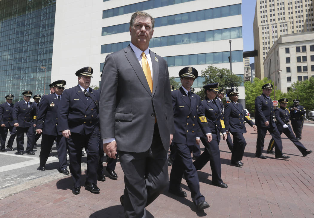 Dallas Mayor Mike Rawlings helps lead a march by police officers during a memorial service in downtown Dallas, Wednesday, May 17, 2017. The Dallas Police Department and city leaders held a ceremon ...