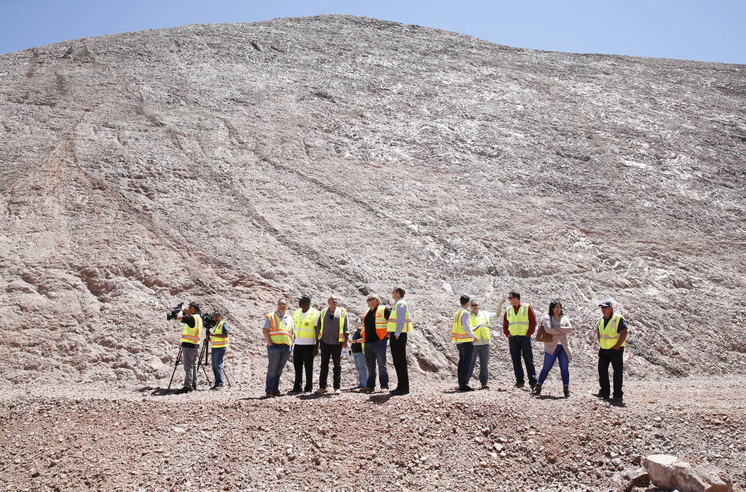 Members of the media during a tour of the I-11construction site near Lake Mead on Friday, May 19, 2017, in Boulder City. Construction of the first 15 miles of I-11, which will link Las Vegas to Ph ...