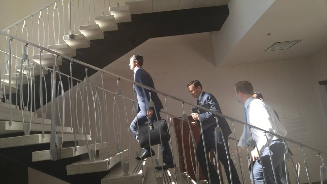 Attorney General Adam Laxalt walks up a staircase of the Legislative Building in Carson City before a meeting with lawmakers about the circumstances of his meeting with Nevada Gaming Control Board ...