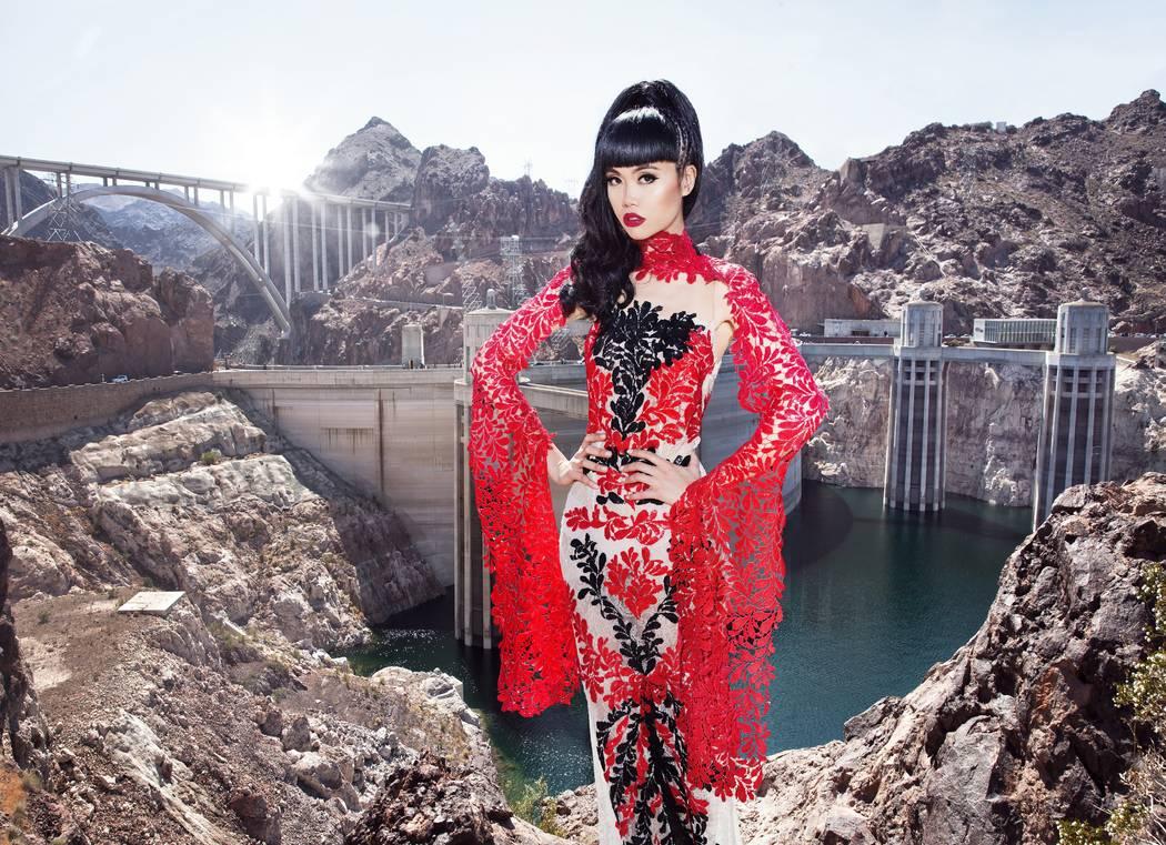Jessica Minh Anh in a lace gown designed by Ani Alvarez Calderon of Lima, Peru.  John Oakley
