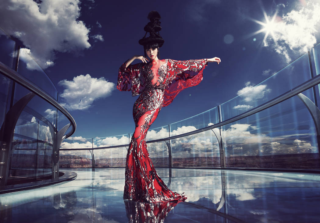 A gown by Hoang Hai, a member of the Asian Couture Federation and the 2013 winner of Project Runway Vietnam, worn by fashion show producer Jessica Minh Anh on the Grand Canyon Skywalk.  John Oakley