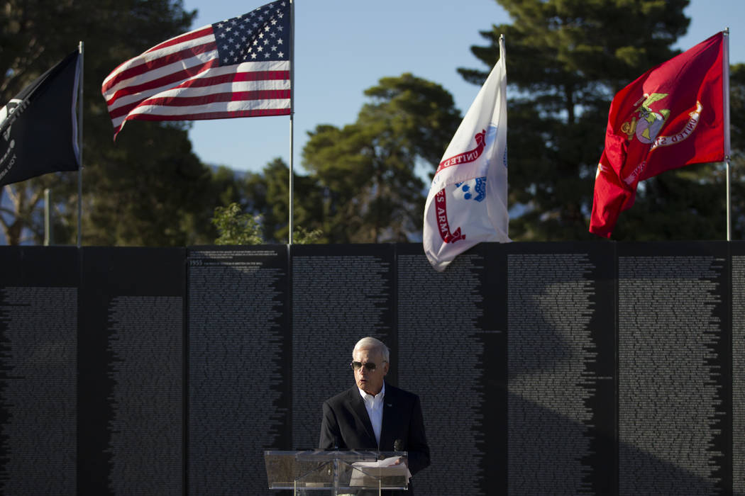 U.S. Air Force veteran Hugh Sinnock speaks during the opening ceremony of the replica of Vietnam Veterans Memorial Wall hosted by the American Veterans Traveling Tribute at Craig Ranch Park on Fri ...
