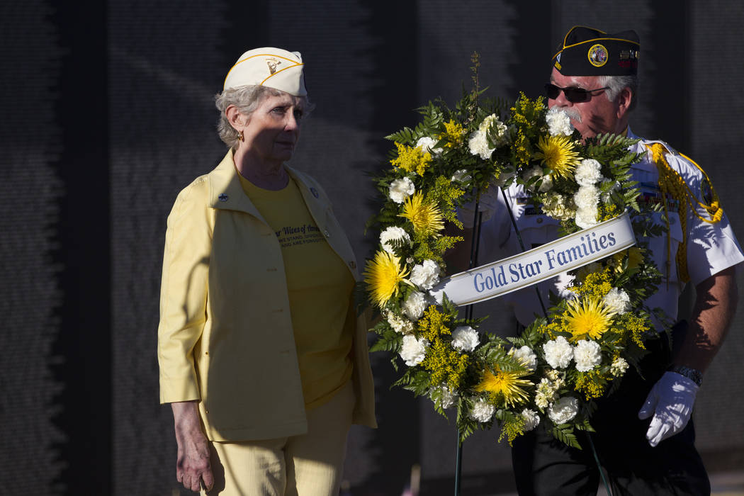 Ada McArthur, left, Gold Star Wife and Vietnam widow of 49 years, and Neil Johnson, president of the Vietnam Veterans of America Chapter 1076, during the opening ceremony for the replica of Vietna ...