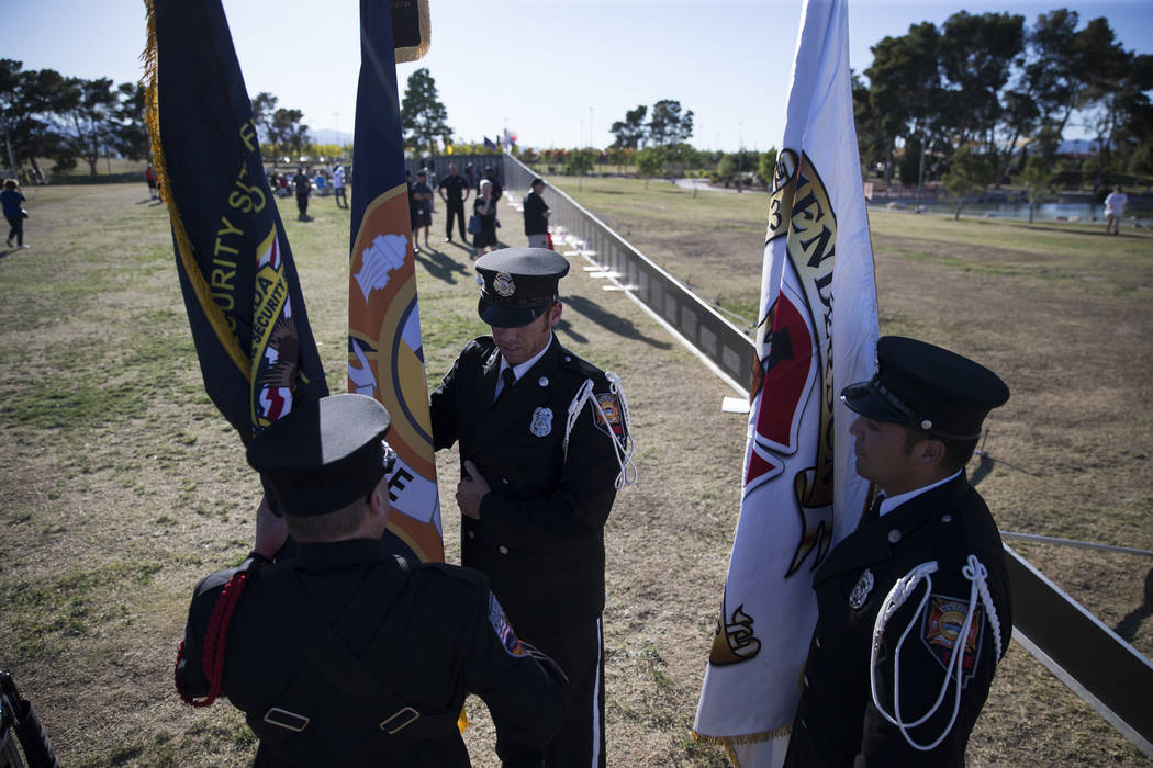 Members of a local multi-agency honor guard before the opening ceremony for the replica Vietnam Veterans Memorial Wall hosted by the American Veterans Traveling Tribute at Craig Ranch Park on Frid ...