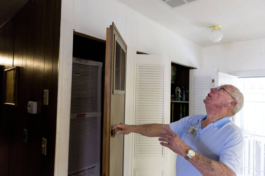 HELP of Southern Nevada outreach coordinator Jim Hutchison explains the recently installed energy efficient products into a home in Las Vegas, Thursday, May 19, 2017. Elizabeth Brumley Las Vegas R ...