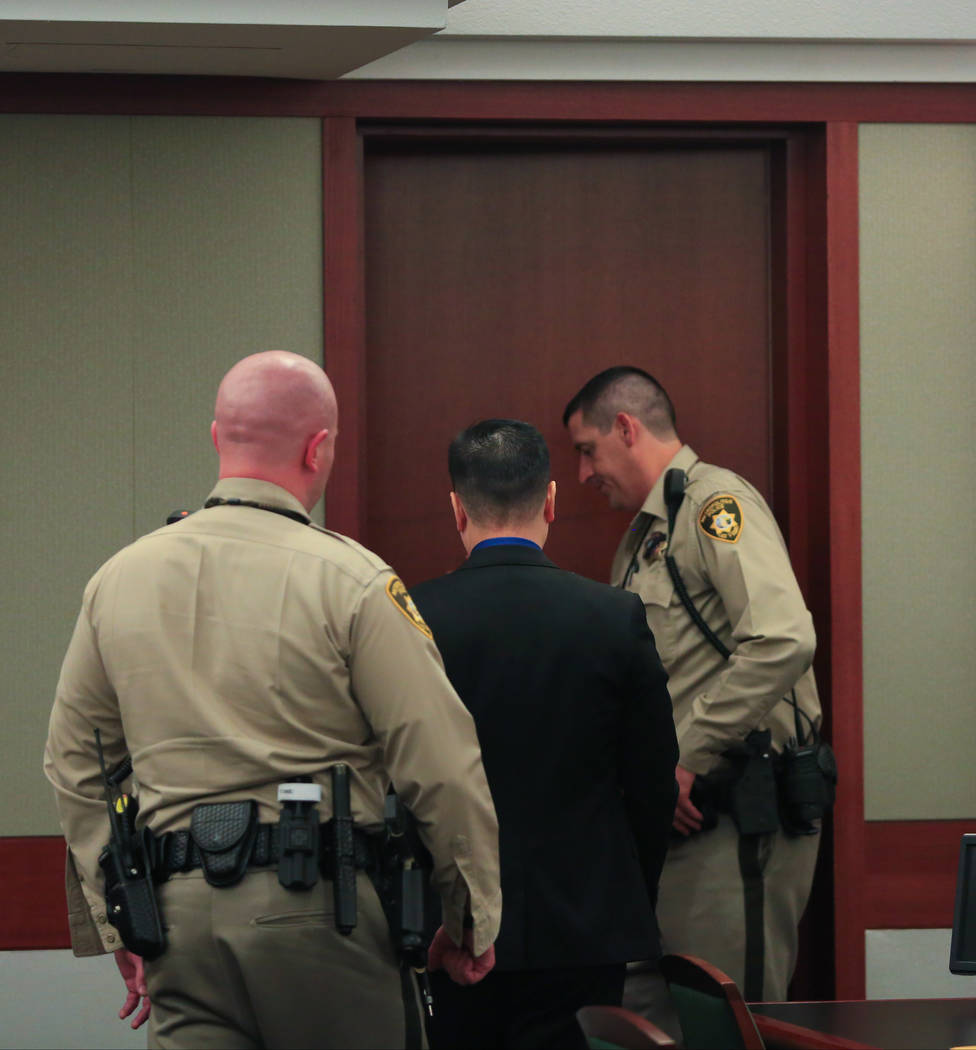 Binh Minh Chung, a doctor who is accused of video taping himself having sex with patients, is led out of the courtroom during his trial at the Regional Justice Center in Las Vegas on Thursday, May ...