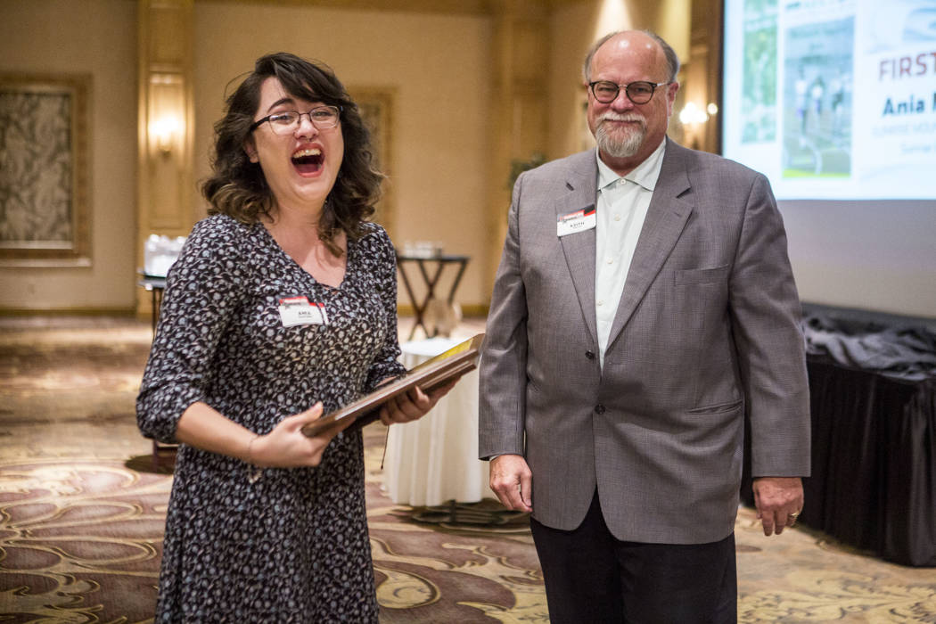 Ania Martinez, editor-in-chief of the Sunrise Mountain Echo, celebrates after accepting the first place award for best newspaper (11x14) from Las Vegas Review-Journal Editor-in-Chief Keith Moyer d ...