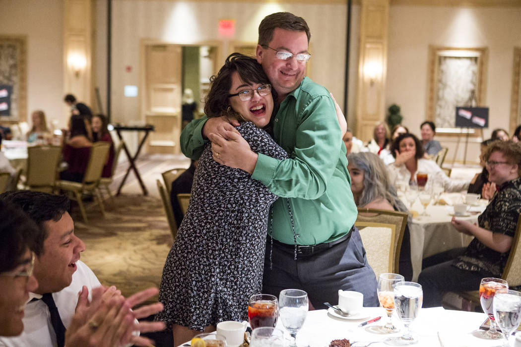 Ania Martinez, editor-in-chief of the Sunrise Mountain Echo, hugs the paper's adviser, Holger Stolzenberg, after winning first place for best newspaper (11x14) during the Las Vegas Review-Journal  ...