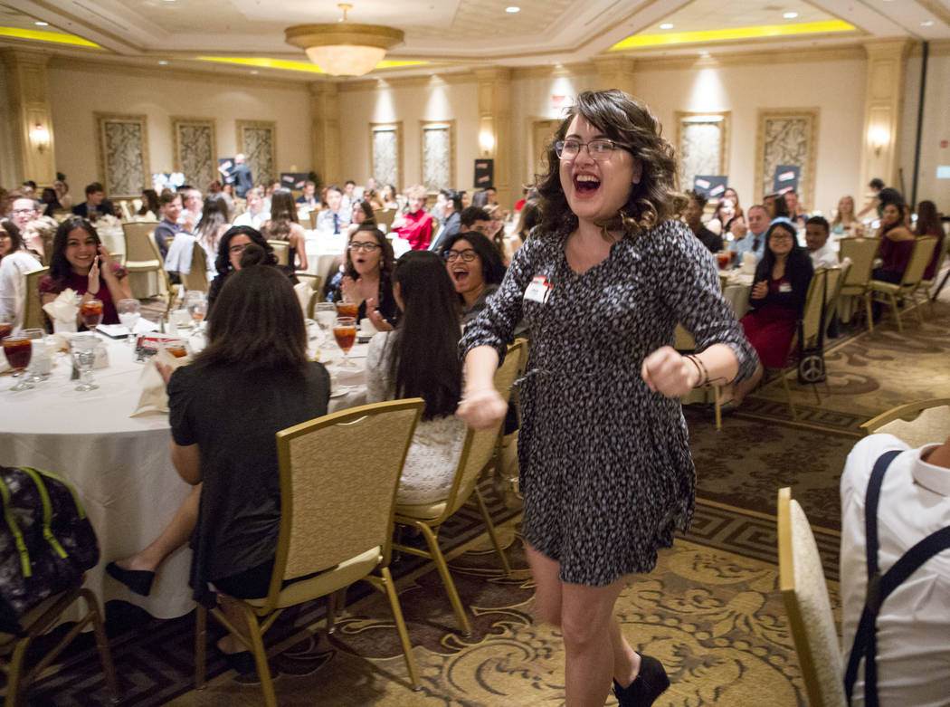 Ania Martinez, editor-in-chief of the Sunrise Mountain Echo, runs to accept the first place award for best newspaper (11x14) during the Las Vegas Review-Journal High School Journalism Awards at th ...