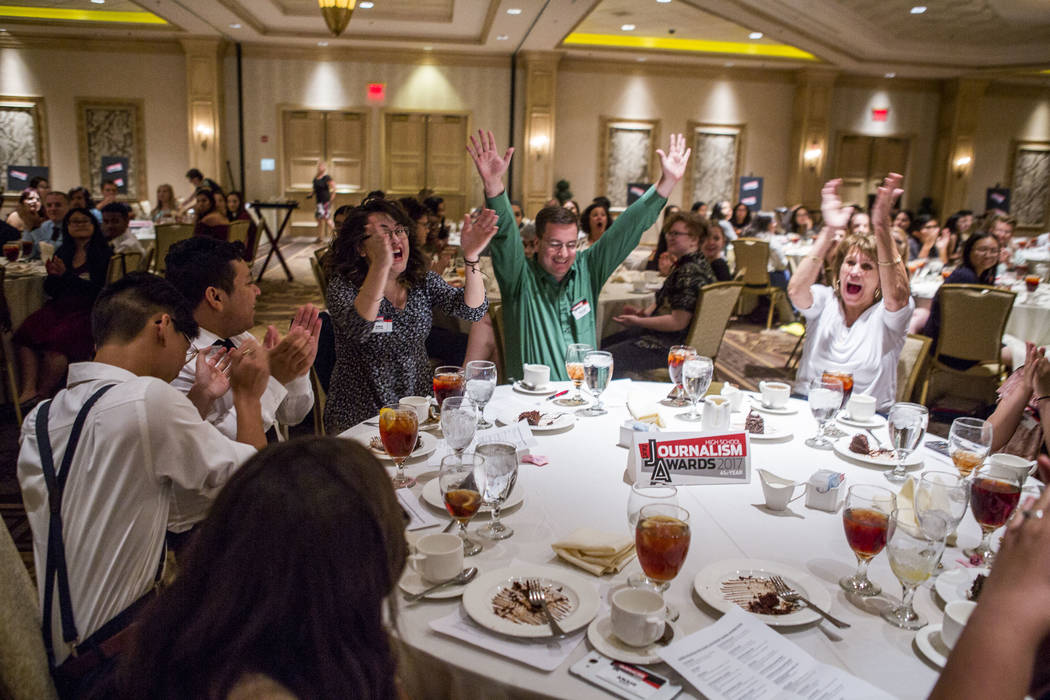 Members of the Sunrise Mountain Echo newspaper celebrate after winning first place for best newspaper (11x14) during the Las Vegas Review-Journal High School Journalism Awards at the Suncoast hote ...