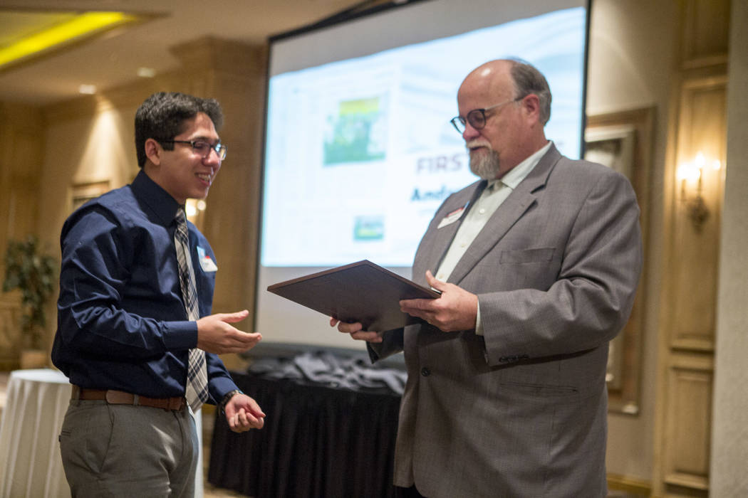 "Andrew Mendez of Spring Valley High School accepts first place for the ""First Amendment"" category from Las Vegas Review-Journal Editor-in-Chief Keith Moyer during the Review-Journal High School Jo ..."