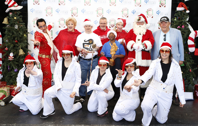 Las Vegas Mayor Carolyn Goodman, second left, stands for a photo with Alan Rothwell, left, race director of Liverpool's Santa Dash; Linda Smith, third from left, Opportunity Village's associate ex ...