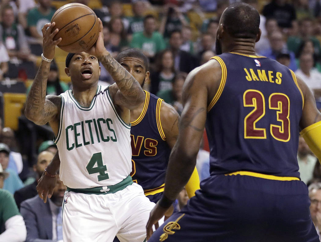 Boston Celtics guard Isaiah Thomas (4) prepares to shoot as Cleveland Cavaliers forward LeBron James (23) defends during the first quarter of Game 1 of the NBA basketball Eastern Conference finals ...