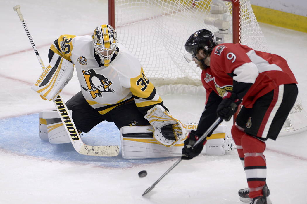 Ottawa Senators right wing Bobby Ryan (9) deflects a shot on net as Pittsburgh Penguins goalie Matt Murray (30) makes a save during the second period of game three of the Eastern Conference final  ...
