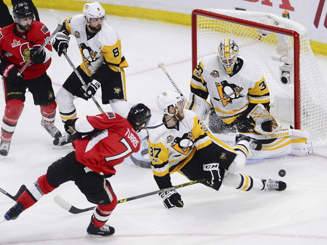 Ottawa Senators center Kyle Turris (7) has his shot blocked by Pittsburgh Penguins right wing Carter Rowney (37) as goalie Matt Murray (30), defenseman Brian Dumoulin (8) and Senators center Tom P ...
