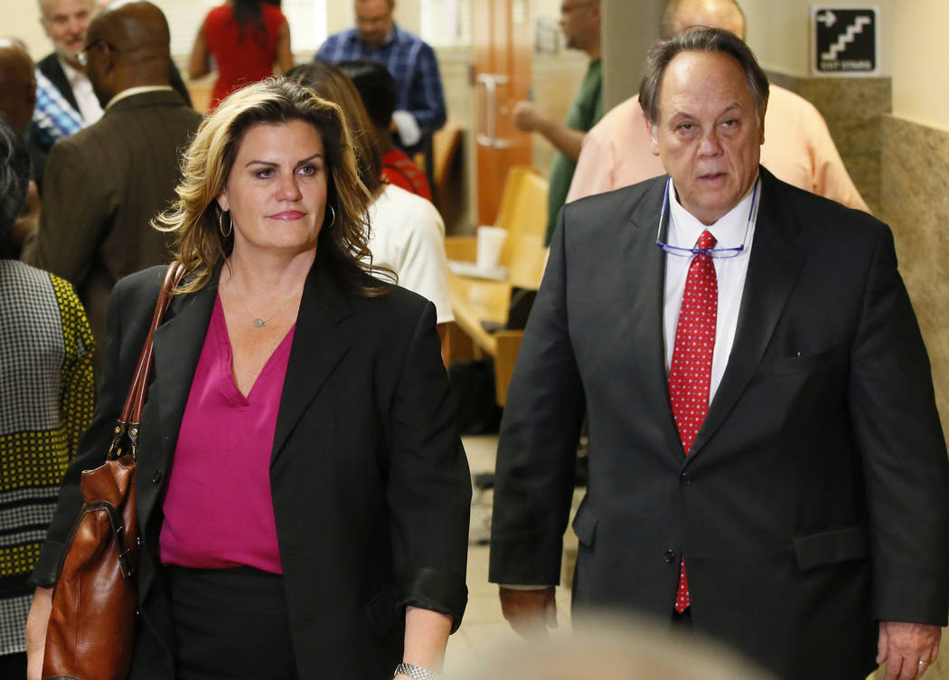 Shannon McMurray, left, and Scott Wood, defense attorneys for Tulsa police officer Betty Jo Shelby, leave the courtroom following a motion in Tulsa, Okla., Wednesday, May 17, 2017. Shelby was char ...