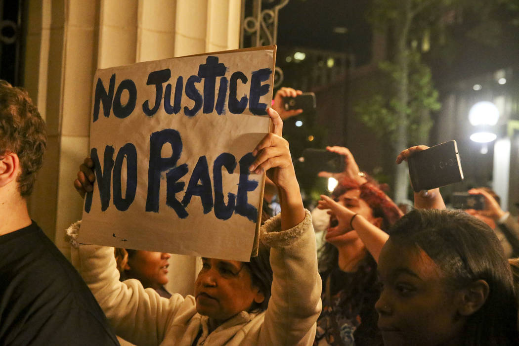 Protesters gather in front of the Mayo Hotel after a not guilty verdict for Tulsa Police Officer Betty Jo Shelby is announced at the Tulsa County Courthouse Wednesday, May 17, 2017, in Tulsa, Okla ...
