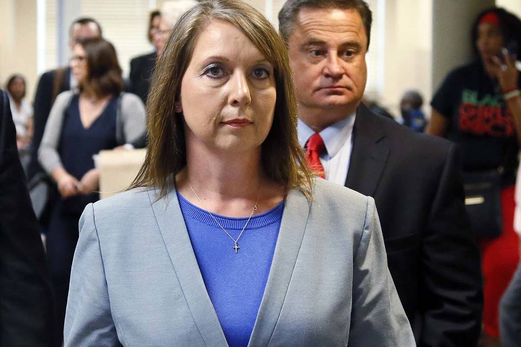Betty Shelby leaves the courtroom with her husband, Dave Shelby, after the jury in her case began deliberations in Tulsa Wednesday, May 17, 2017. Shelby, who fatally shot an unarmed black man last ...