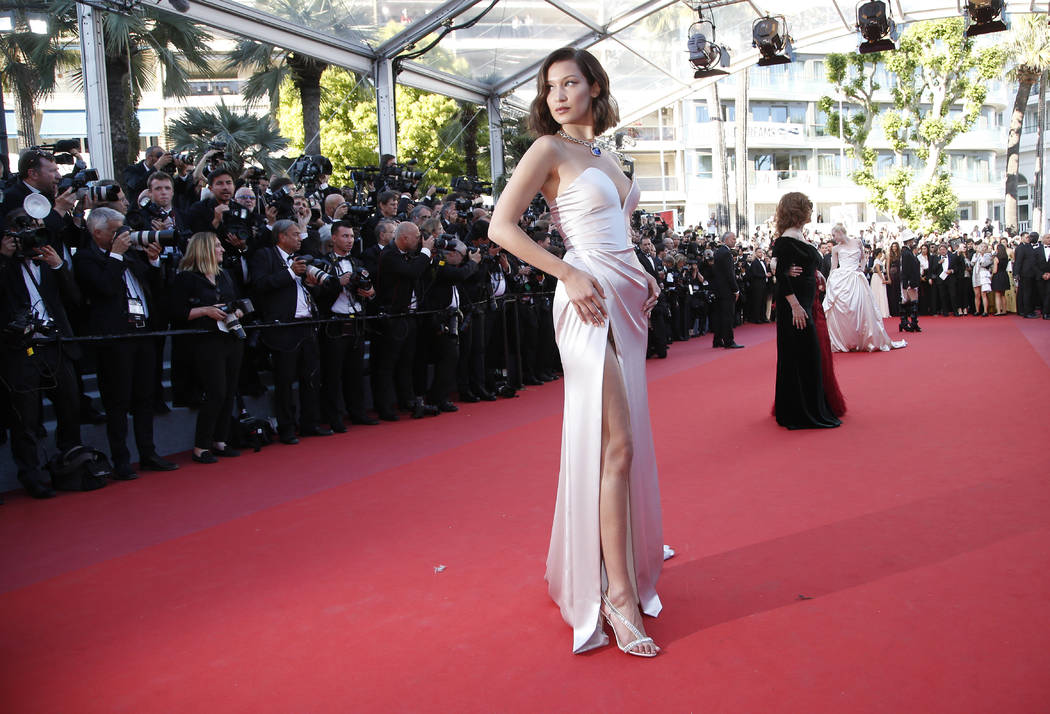Model Bella Hadid poses for photographers upon arrival at the opening ceremony and the screening of the film Ismael's Ghosts at the 70th international film festival, Cannes, southern France, Wedne ...