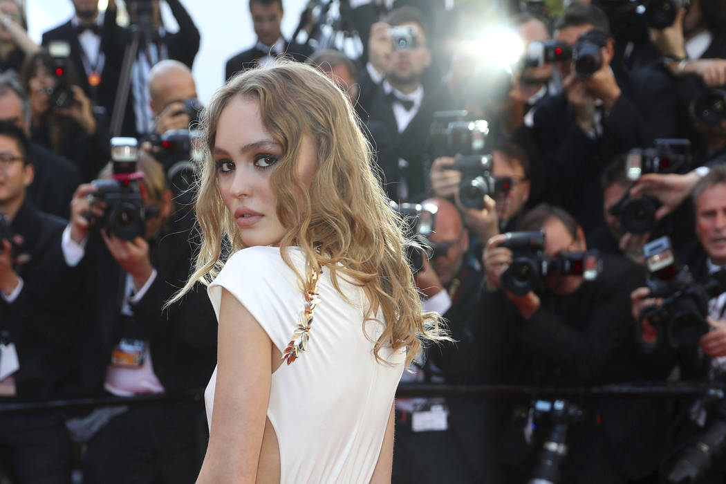 Actress Lily-Rose Depp poses for photographers upon arrival at the opening ceremony and the screening of the film Ismael's Ghosts at the 70th international film festival, Cannes, southern France,  ...