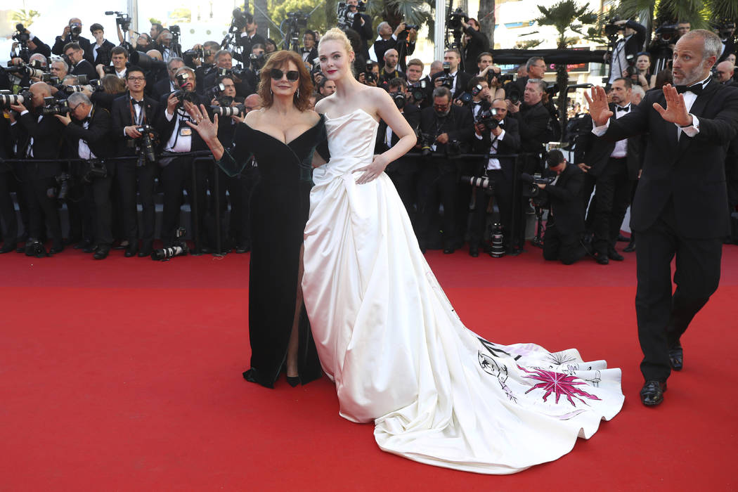Actresses Susan Sarandon and Elle Fanning pose for photographers upon arrival at the opening ceremony and the screening of the film Ismael's Ghosts at the 70th international film festival, Cannes, ...