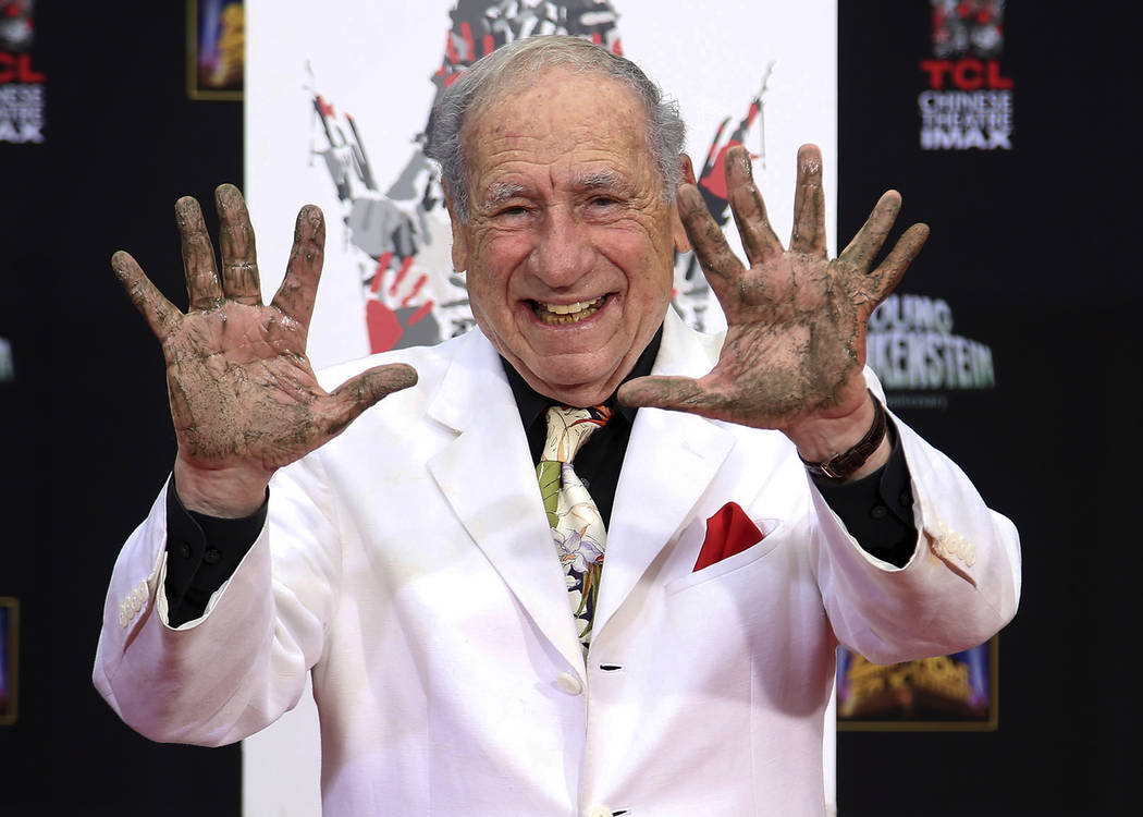 "Director-comedian Mel Brooks displays his cement-covered hands, with his left hand sporting an extra finger, during his Hand and Footprint ceremony on the 40th anniversary of the movie ""Young Fran ..."