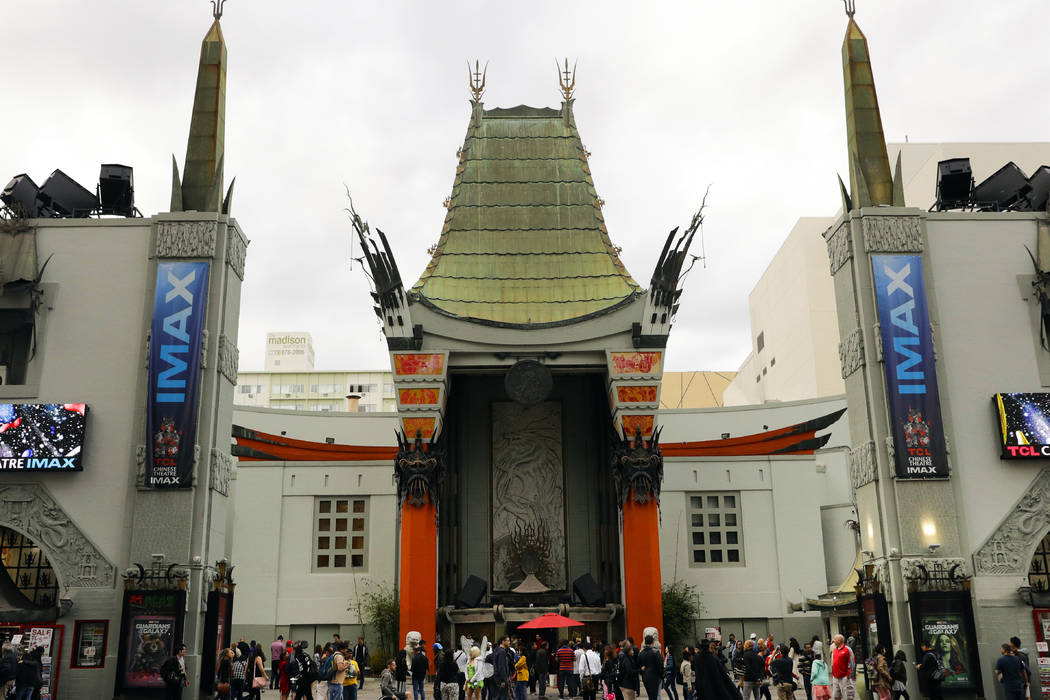 Tourists gather in the forecourt of the TCL Chinese Theatre in the Hollywood section of Los Angeles on May 15, 2017. Older than the Academy Awards and still an industry standout, Hollywood's stori ...
