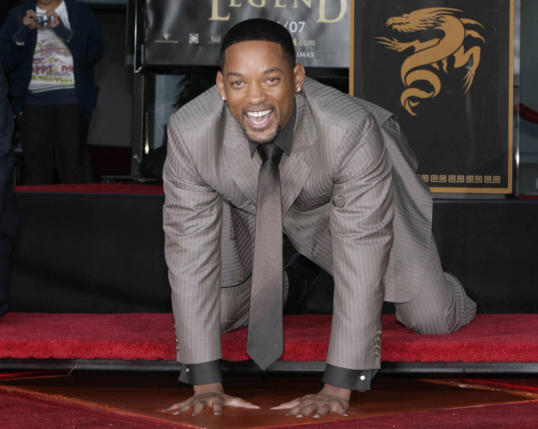 "Actor Will Smith, star of ""I Am Legend,"" places his hands in cement during a hand and footprint ceremony at Grauman's Chinese Theatre in the Hollywood section of Los Angeles on Dec. 10, 2007. (Nic ..."