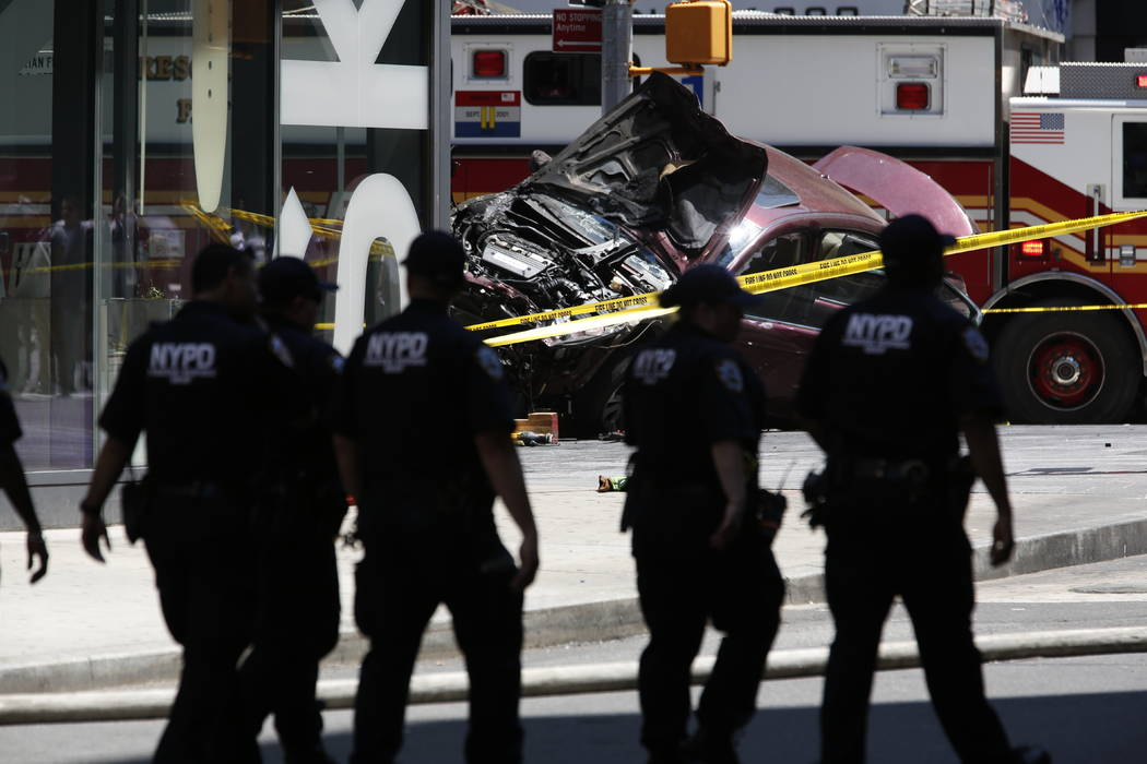 A smashed car sits on the corner of Broadway and 45th Street in New York's Times Square after ploughing through a crowd of pedestrians at lunchtime on Thursday, May 18, 2017. Police do not suspect ...