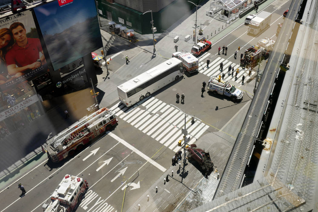New York's Times Square is closed off by police vehicles following a car crash, lower right, Thursday, May 18, 2017.  A man who appeared intoxicated drove his car the wrong way up the Times Square ...